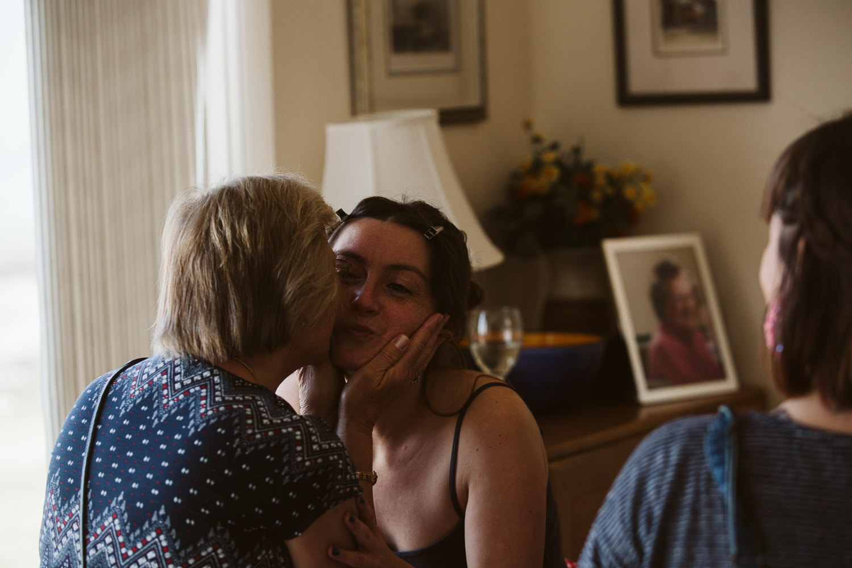 mum kissing the bride