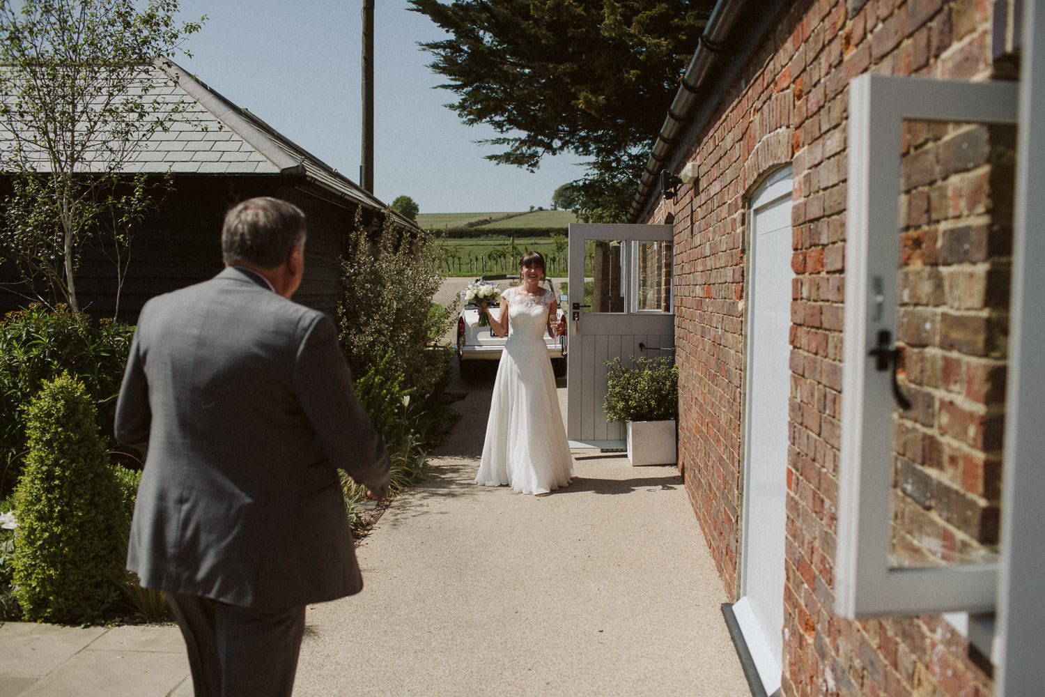the bride walking out of her room into the secret garden