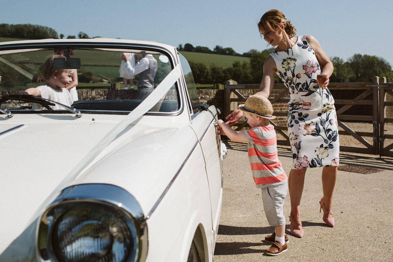 children playing in vintage car