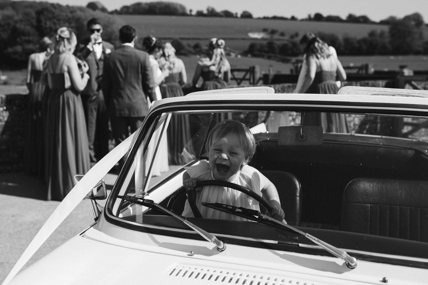 s flower girl having a moment in a vintage car