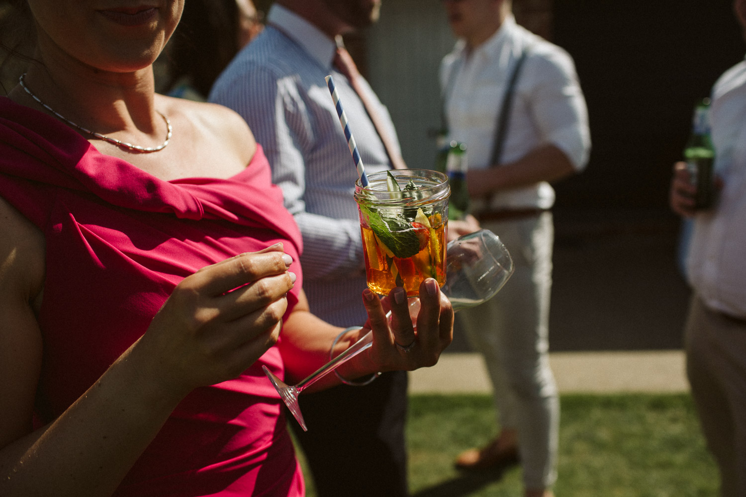 guest holding pimms jar close-up