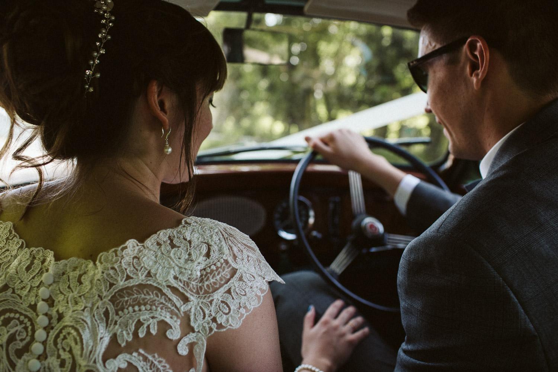 newlyweds driving in car beautiful