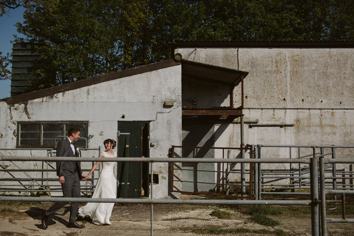 newlyweds walking to a disused cowshed creative lines