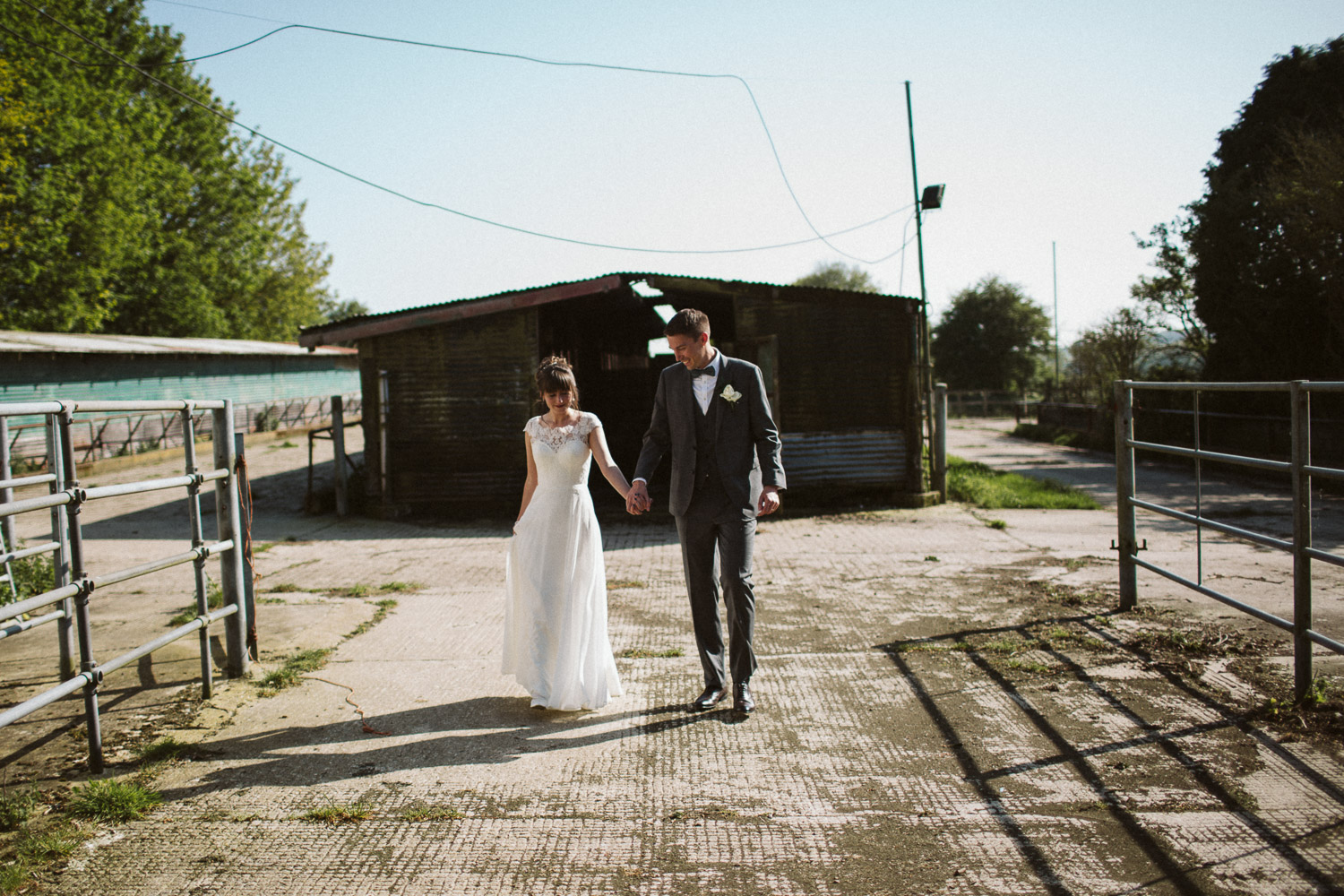 newlyweds in front of a dairy farm