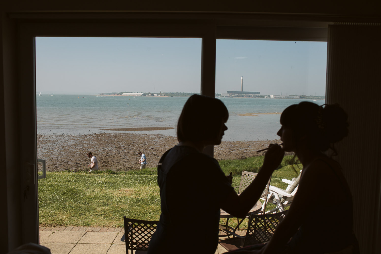 chichester coastline through a window with bride sillhoutte