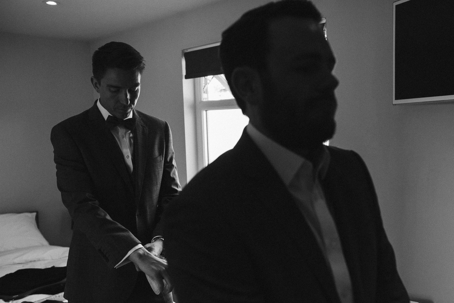 the groom and best man getting ready