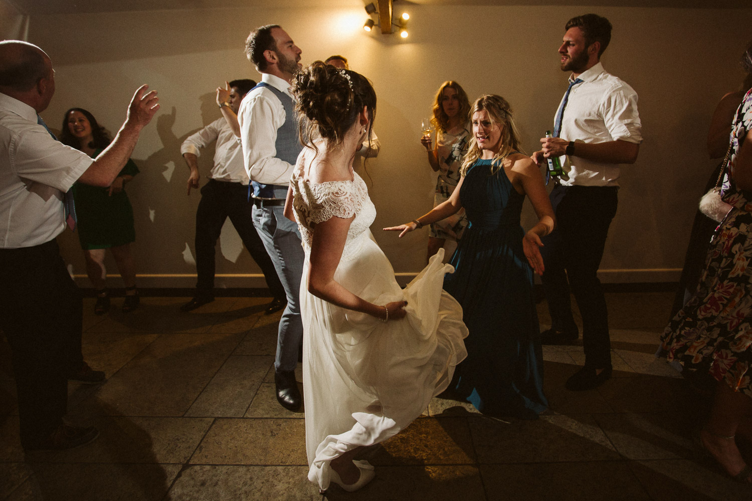 the bride and bridesmaids facing off during a dance