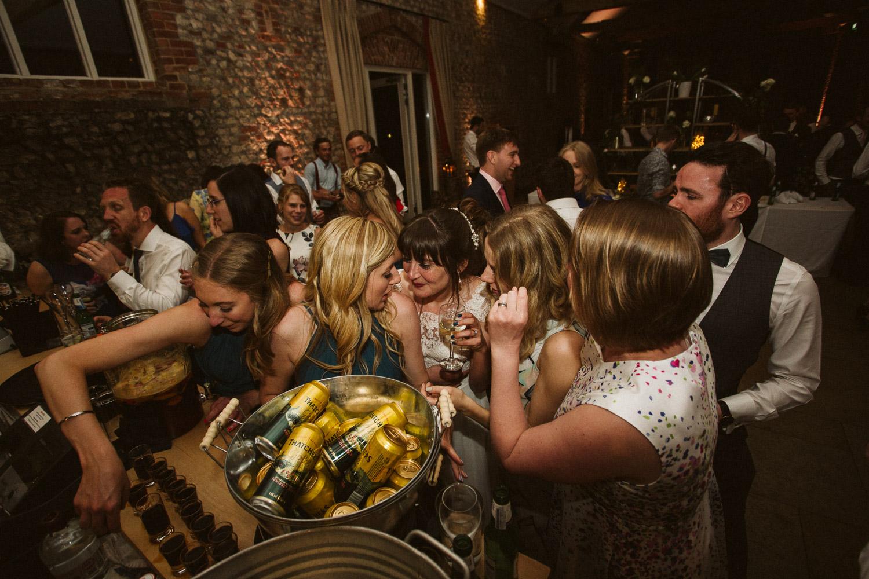 the bride and bridesmaids acting drunk at the bar