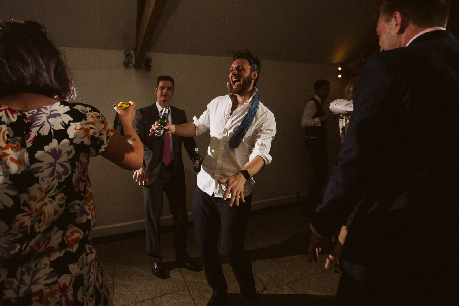 the brides brother dancing with a tie on his head like Rambo