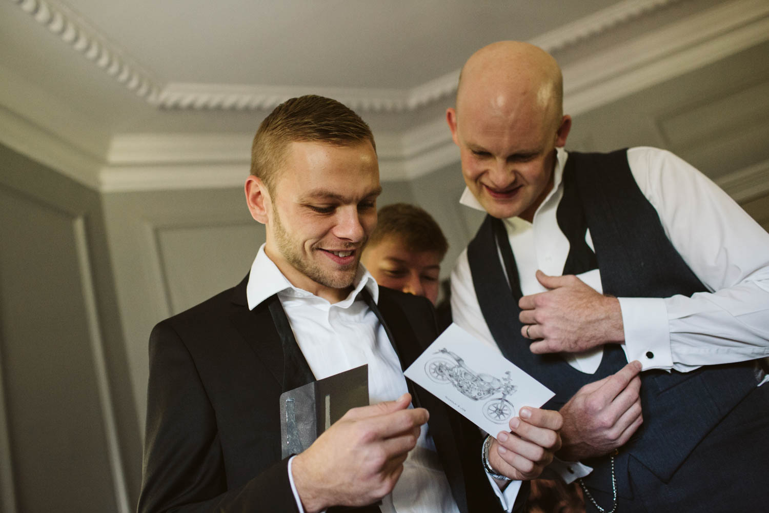 the groomsmen reading a card from the bride