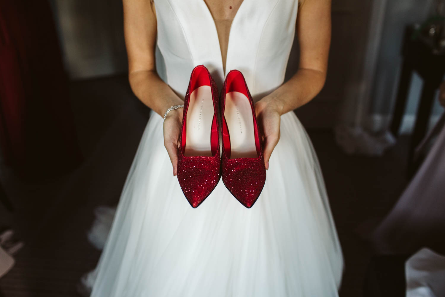 the bride showing off red sparkly shoes