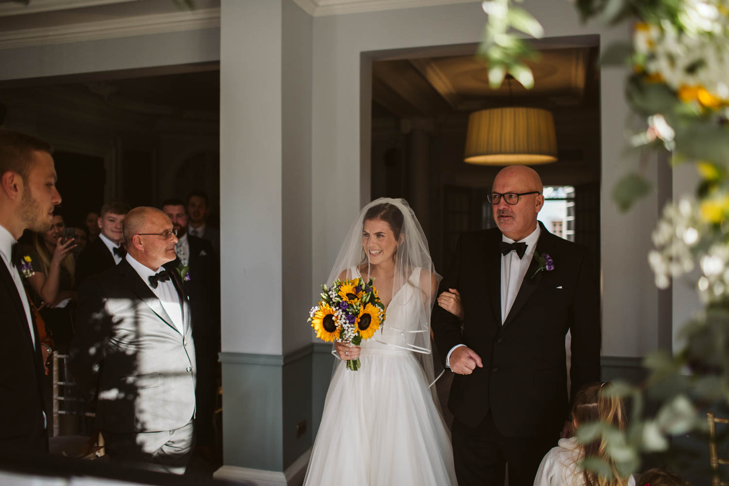 bride and her father arriving really happy