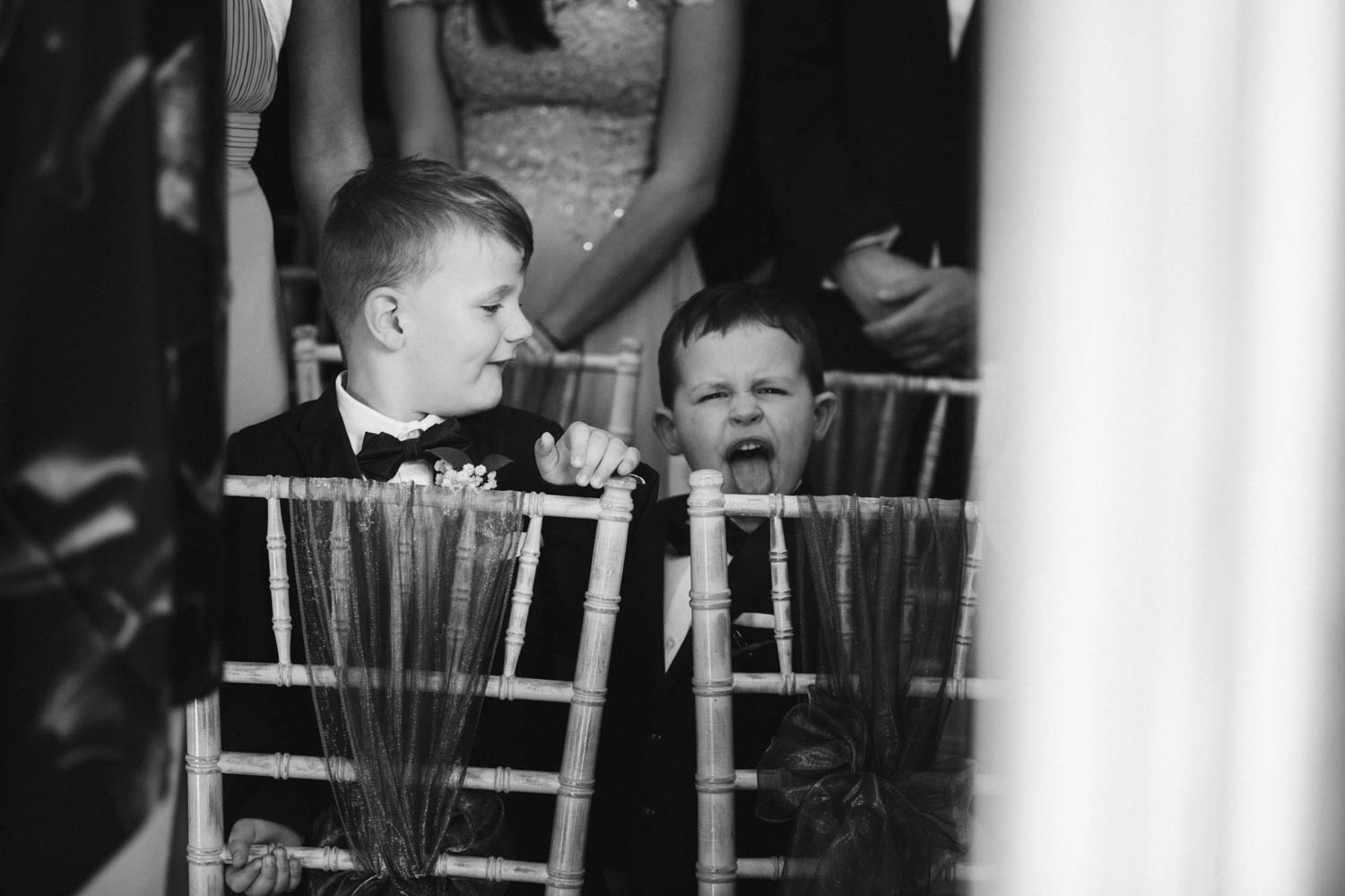 close-up photo of two page boys pulling a funny face