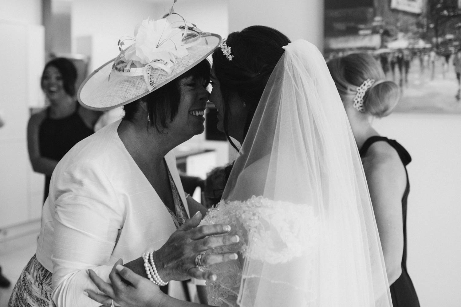 mum and bride rubbing noses together