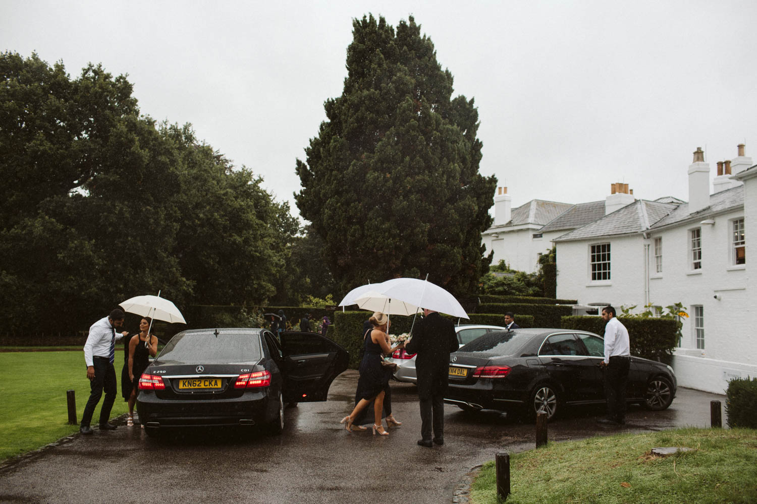guests arriving in the rain