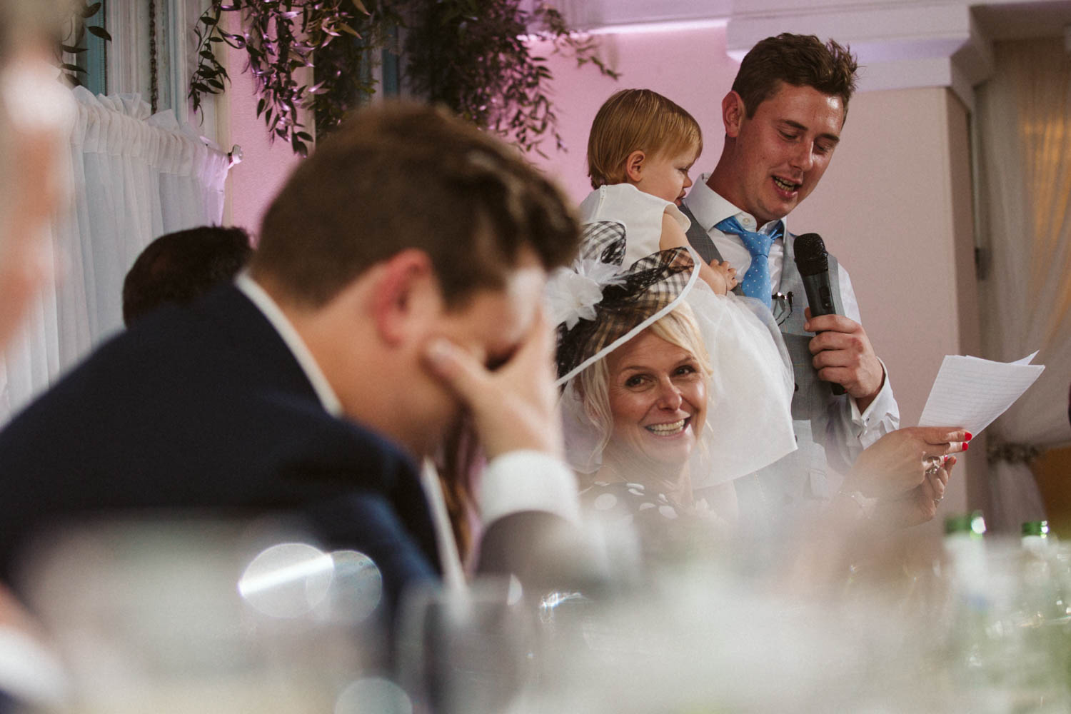 groom covering space during best man speech