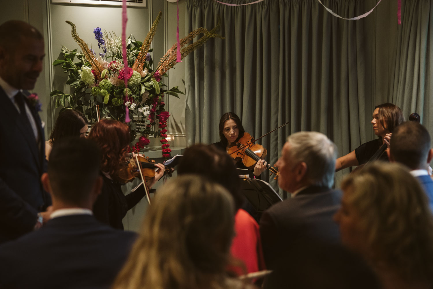 Violinist playing ahead of Bride's entrance