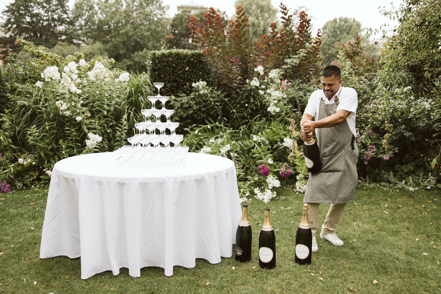 Waiter setting up champagne fountain