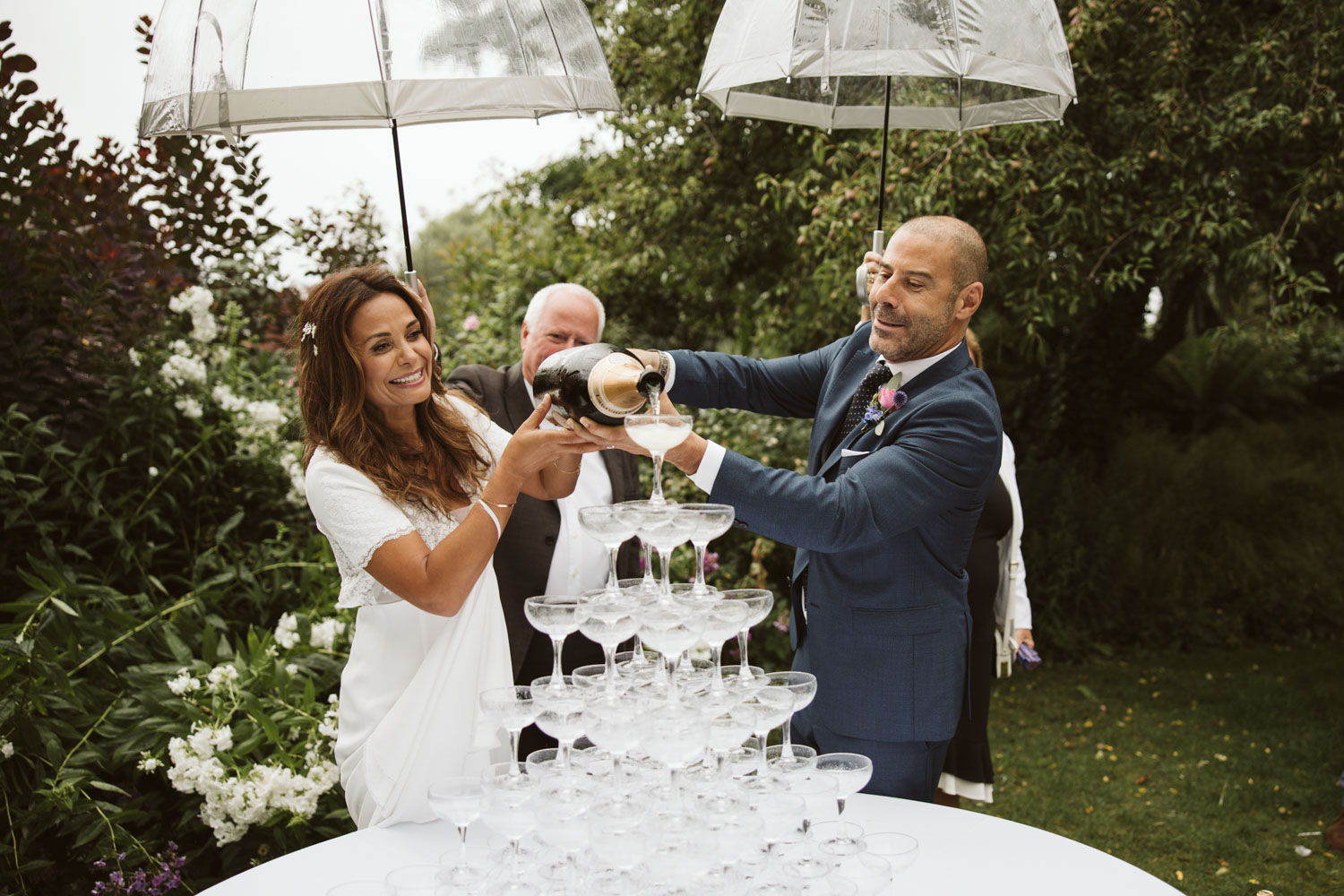 Bride and Groom pouring champagne fountain