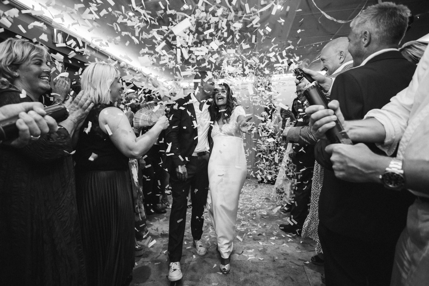 Bride and Groom in confetti cannons at end of Bingham Riverhouse wedding