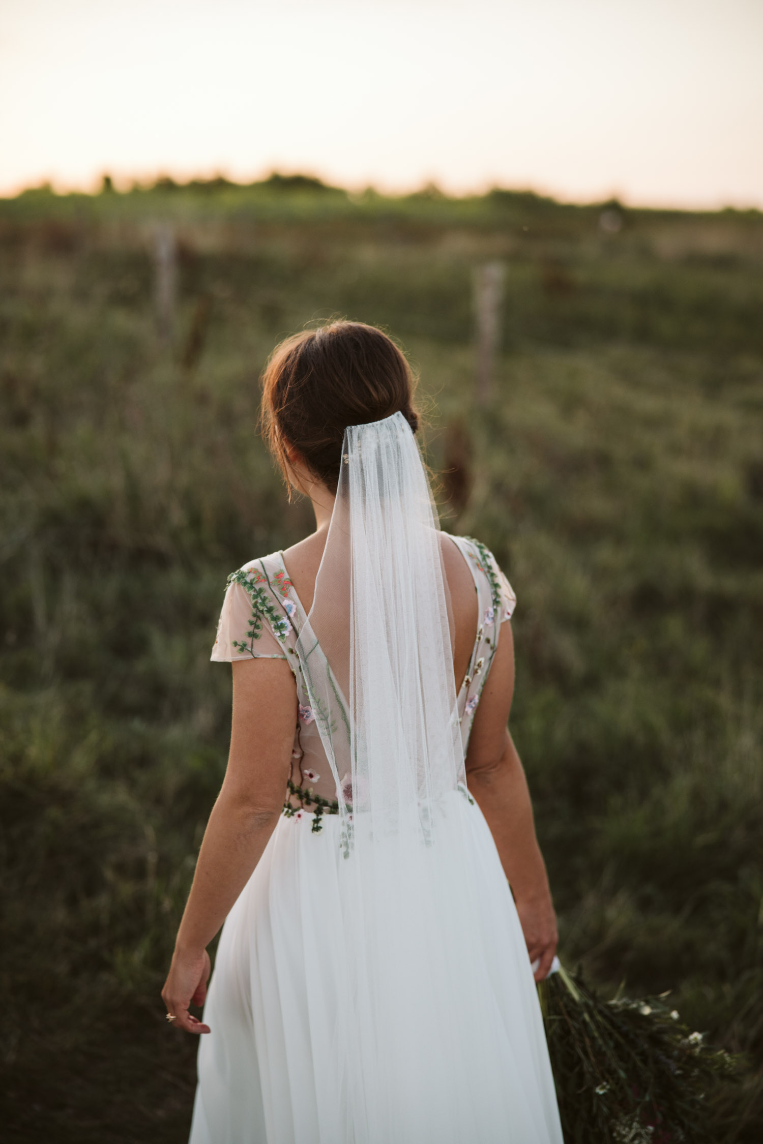 the bride in her dress (the back of the dress shown)