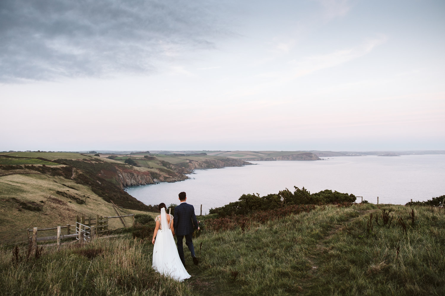 stunning scenery from the clifftop overlooking the sea at sunset