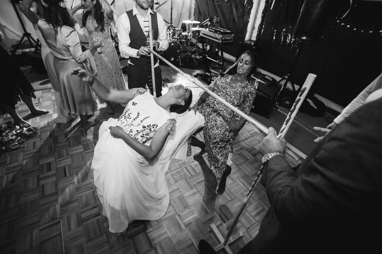 the bride playing limbo on the dancefloor