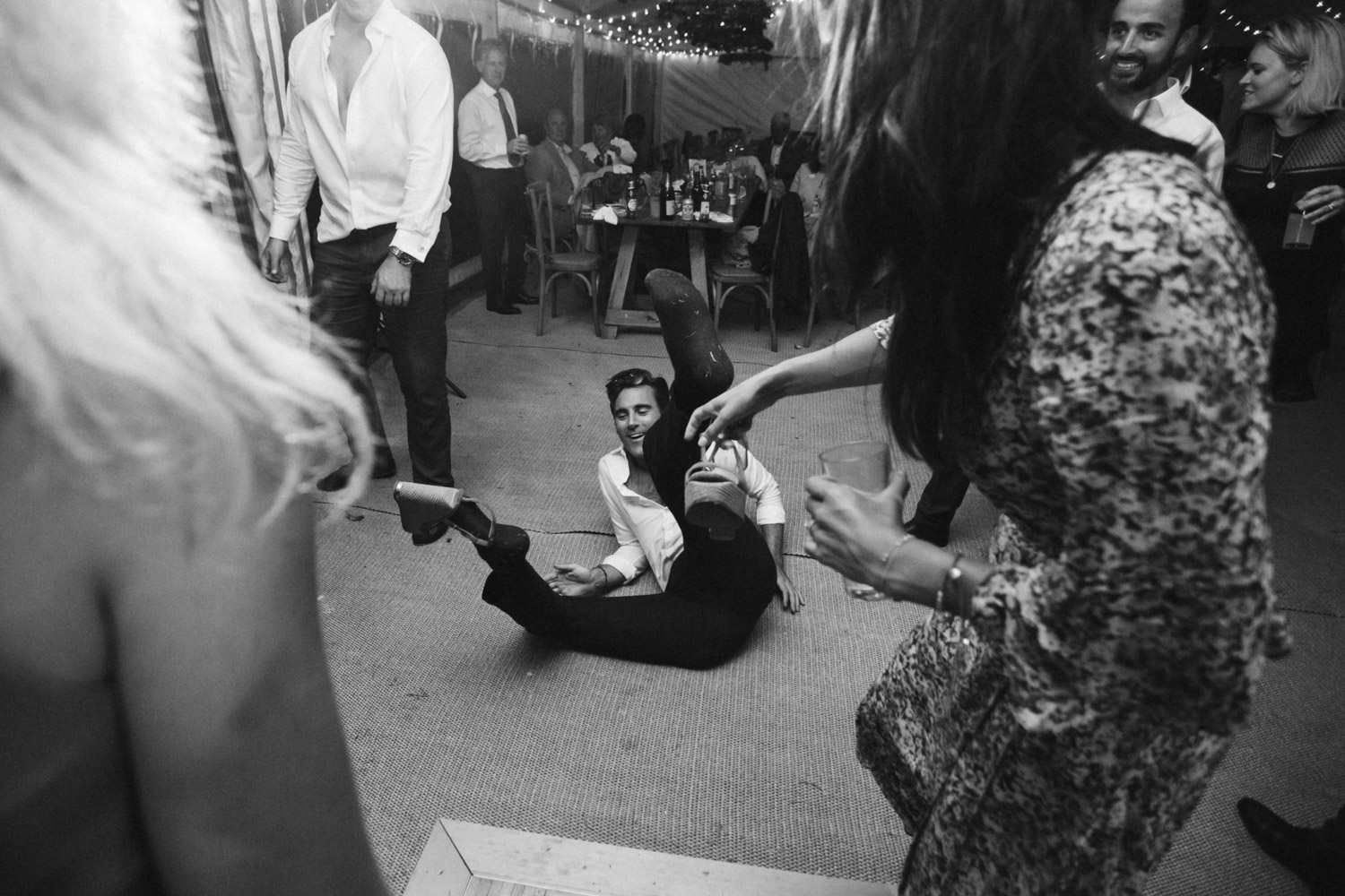 a guest falling over because he's wearing high heels on the dance floor