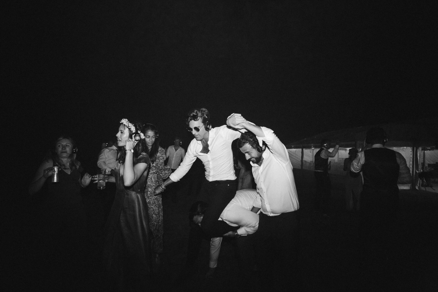 guests dancing on the clifftop after midnight