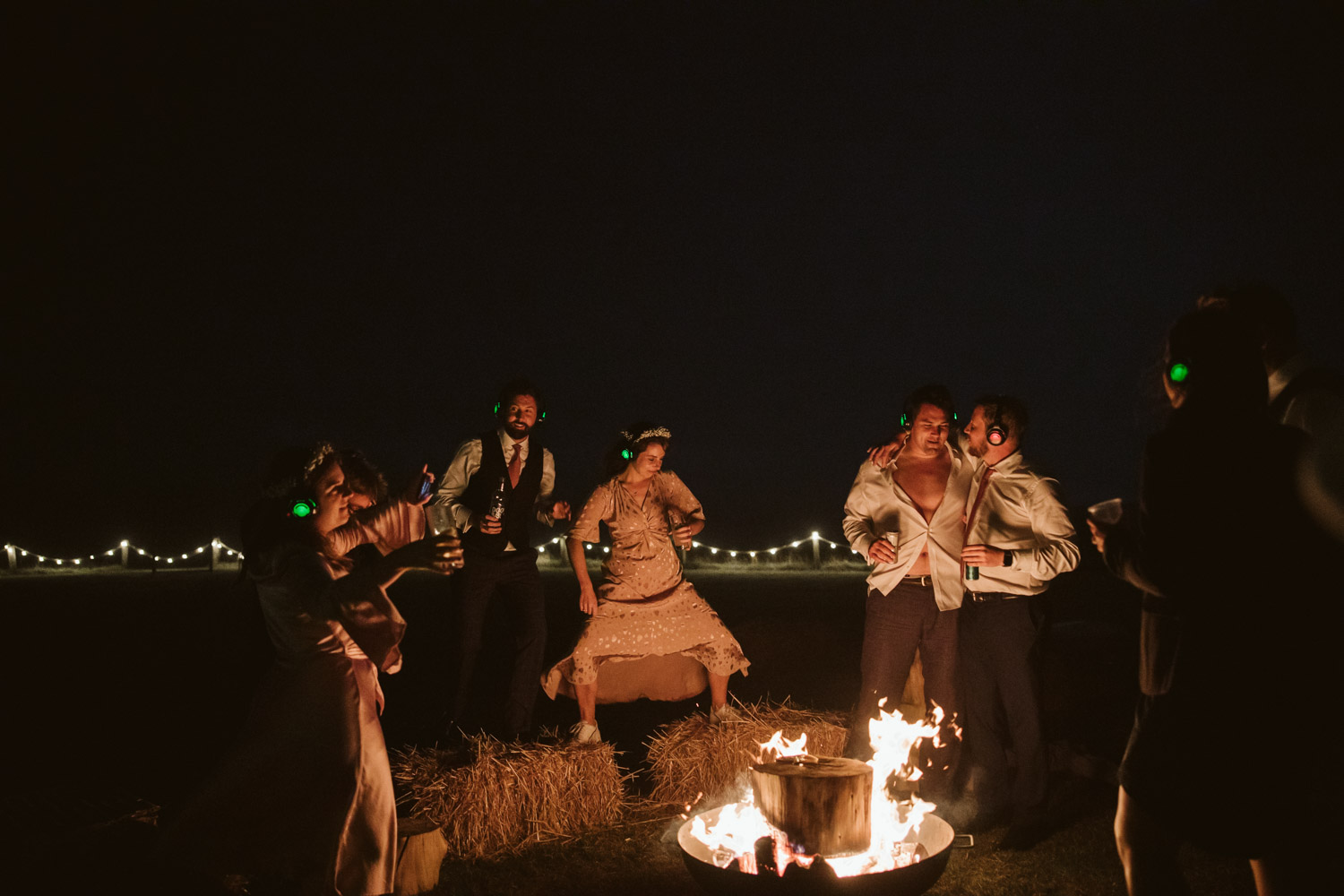 guests dancing by a log fire on the lifts after midnight