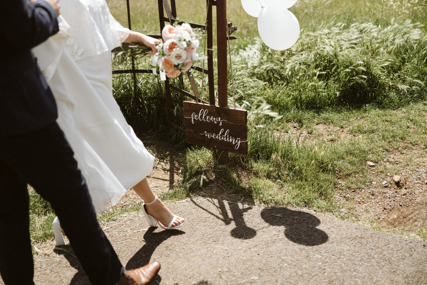 the newly weds walking past the entrance to the hidden valley