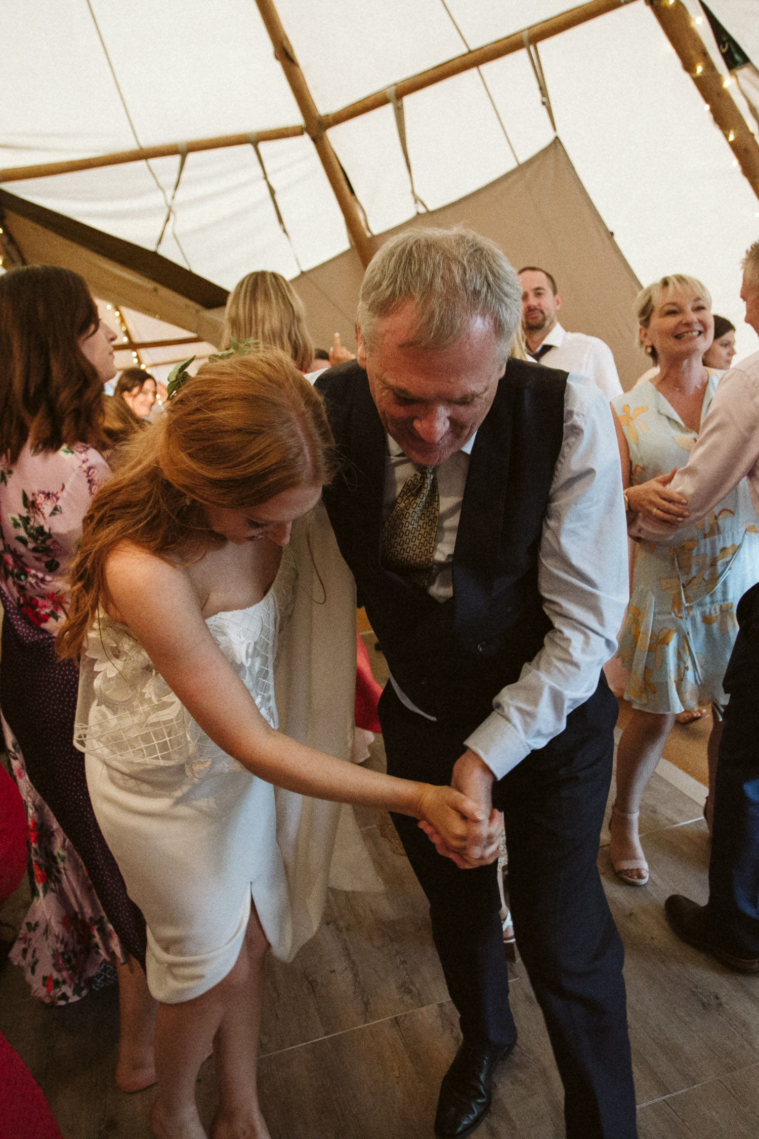 the father and bride are dancing together now