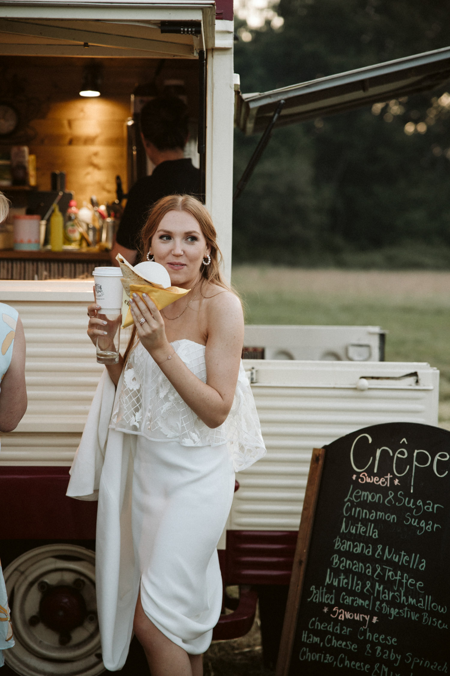 the bride is served a crepe outside the tent