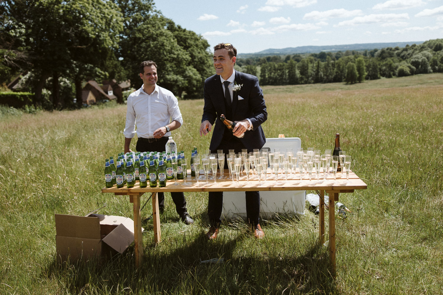 the best man had a table of cold drinks prepared for everyone as they entered the hidden valley