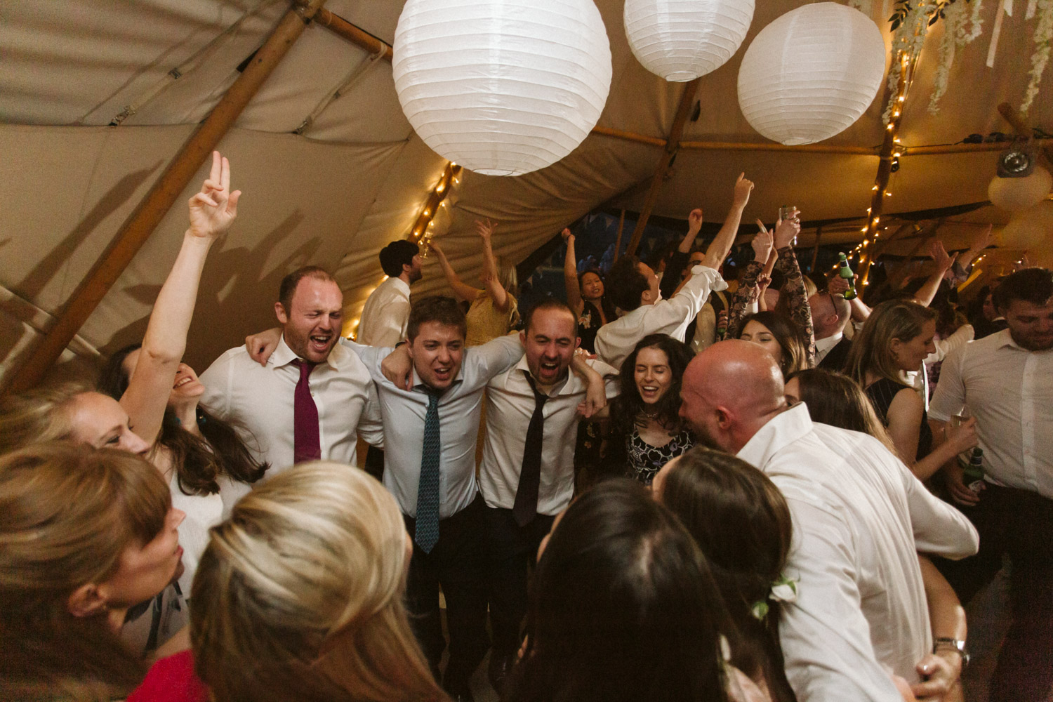 guests dancing in the tipi at night