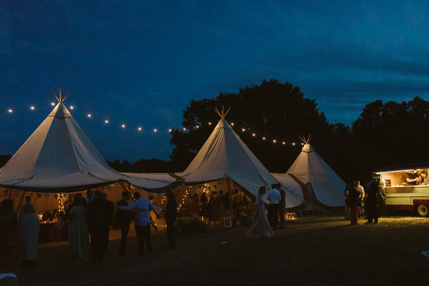 the view of the tipi and fiesta fields at night