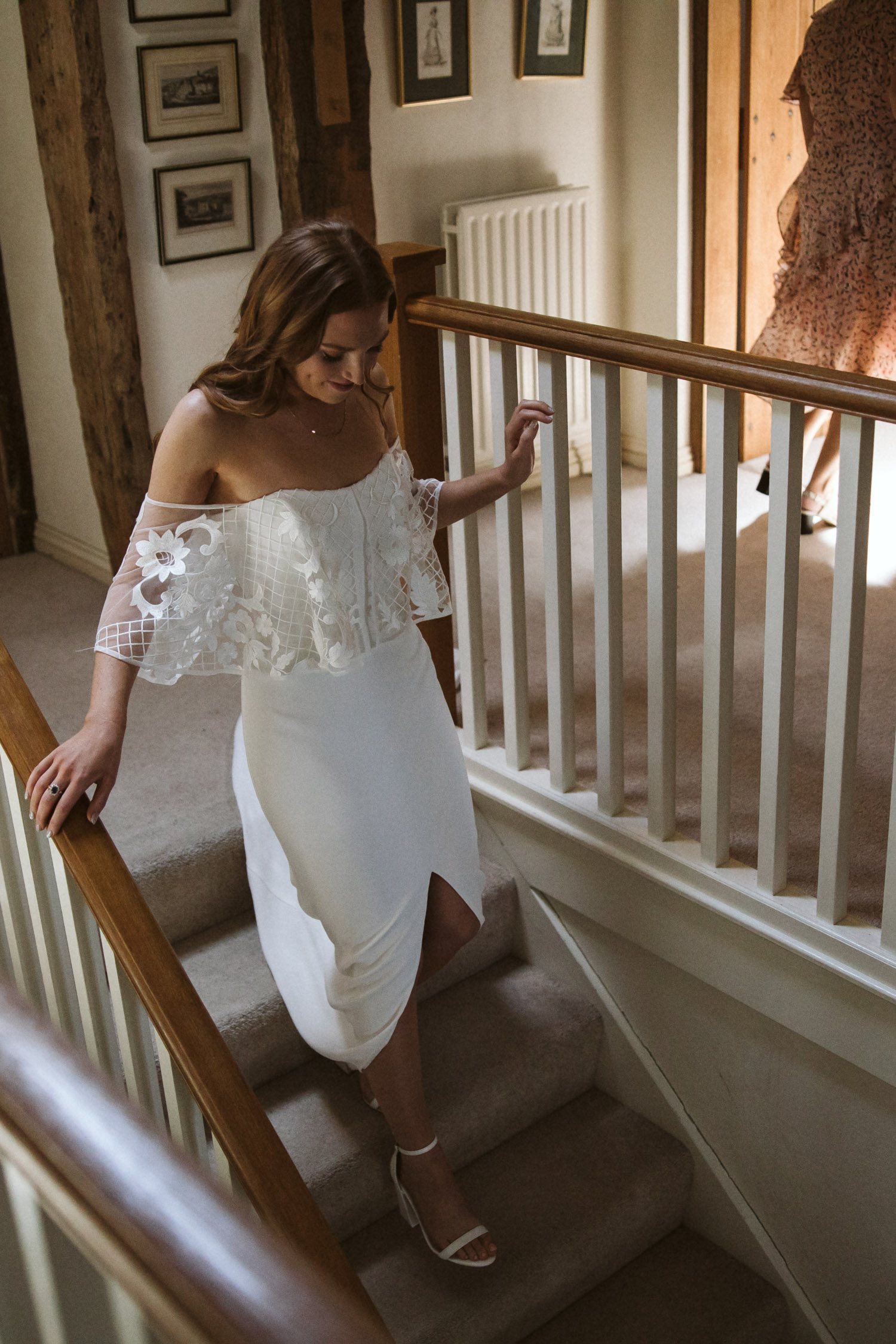 the beautiful bride walking down the stairs