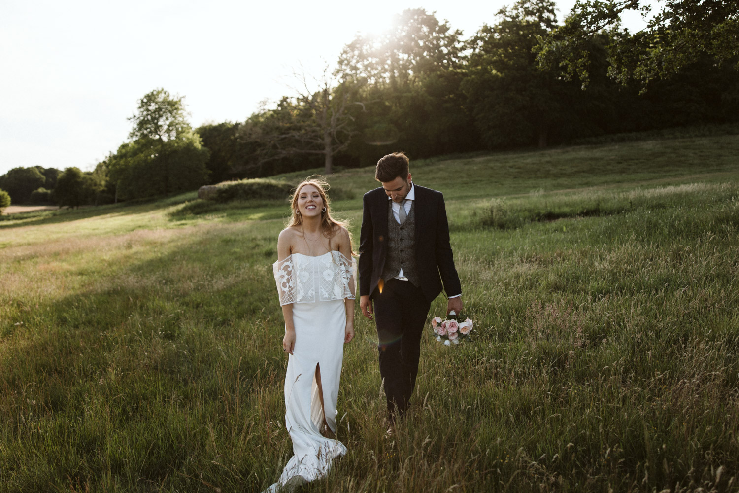a bride and groom portrait in the sunset