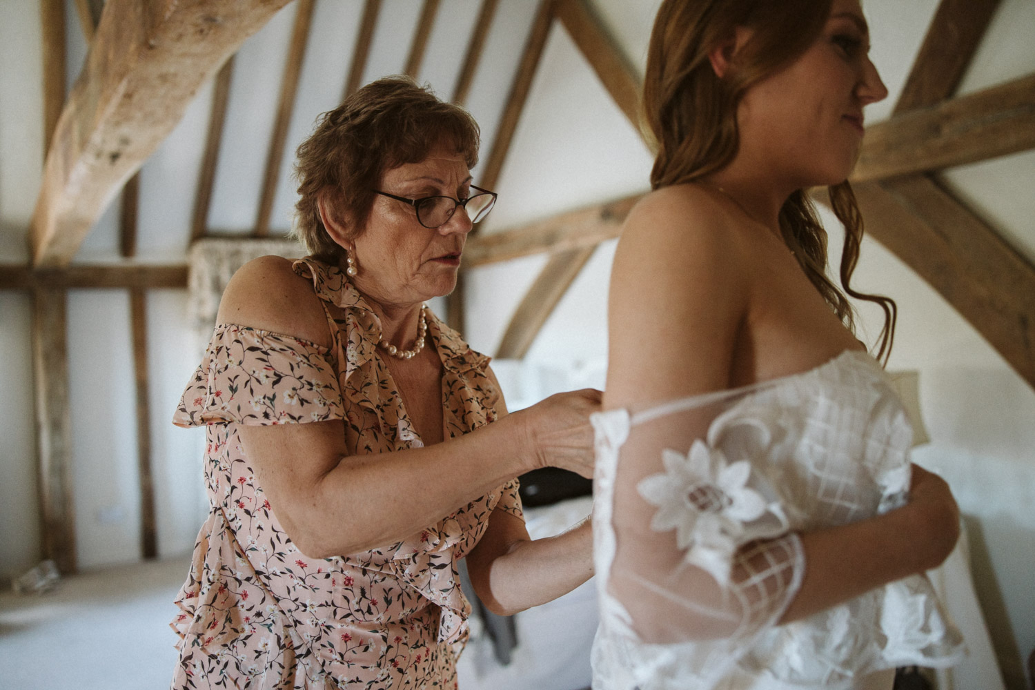 the mother dressing the bride