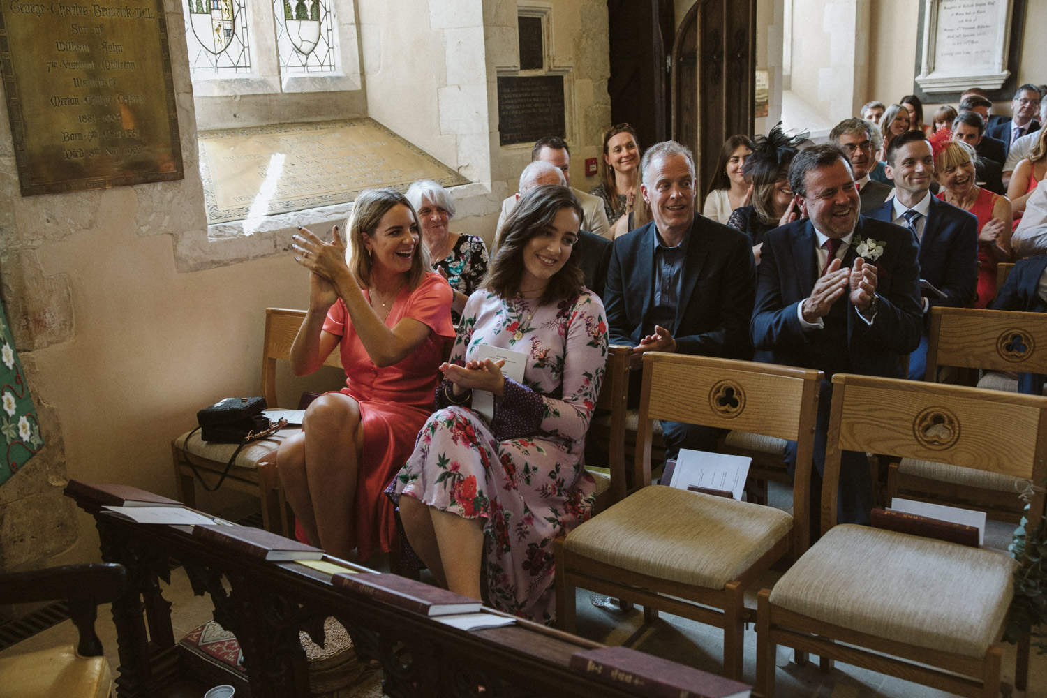guests applauding the newly weds