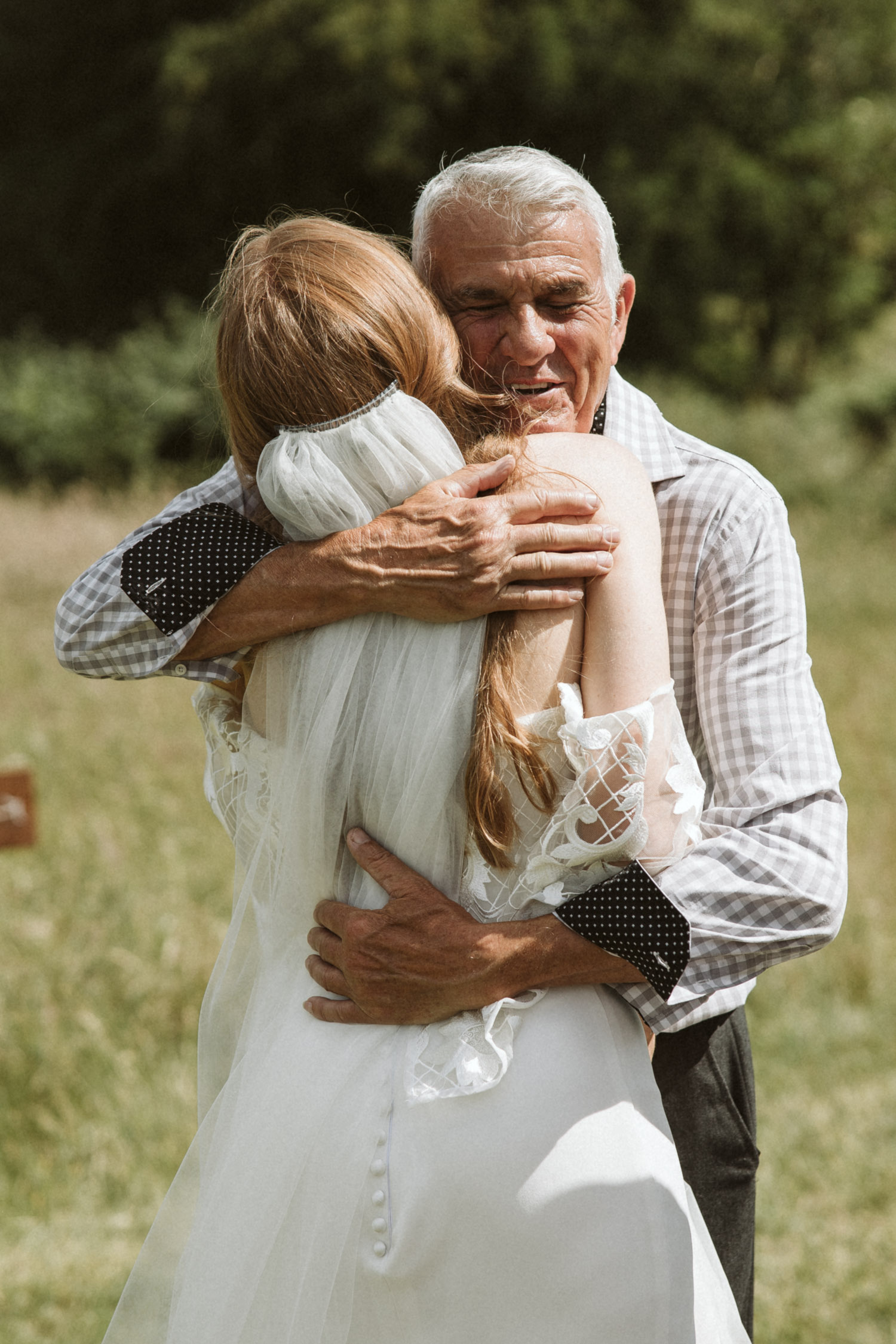 Grandpa hugging the bride