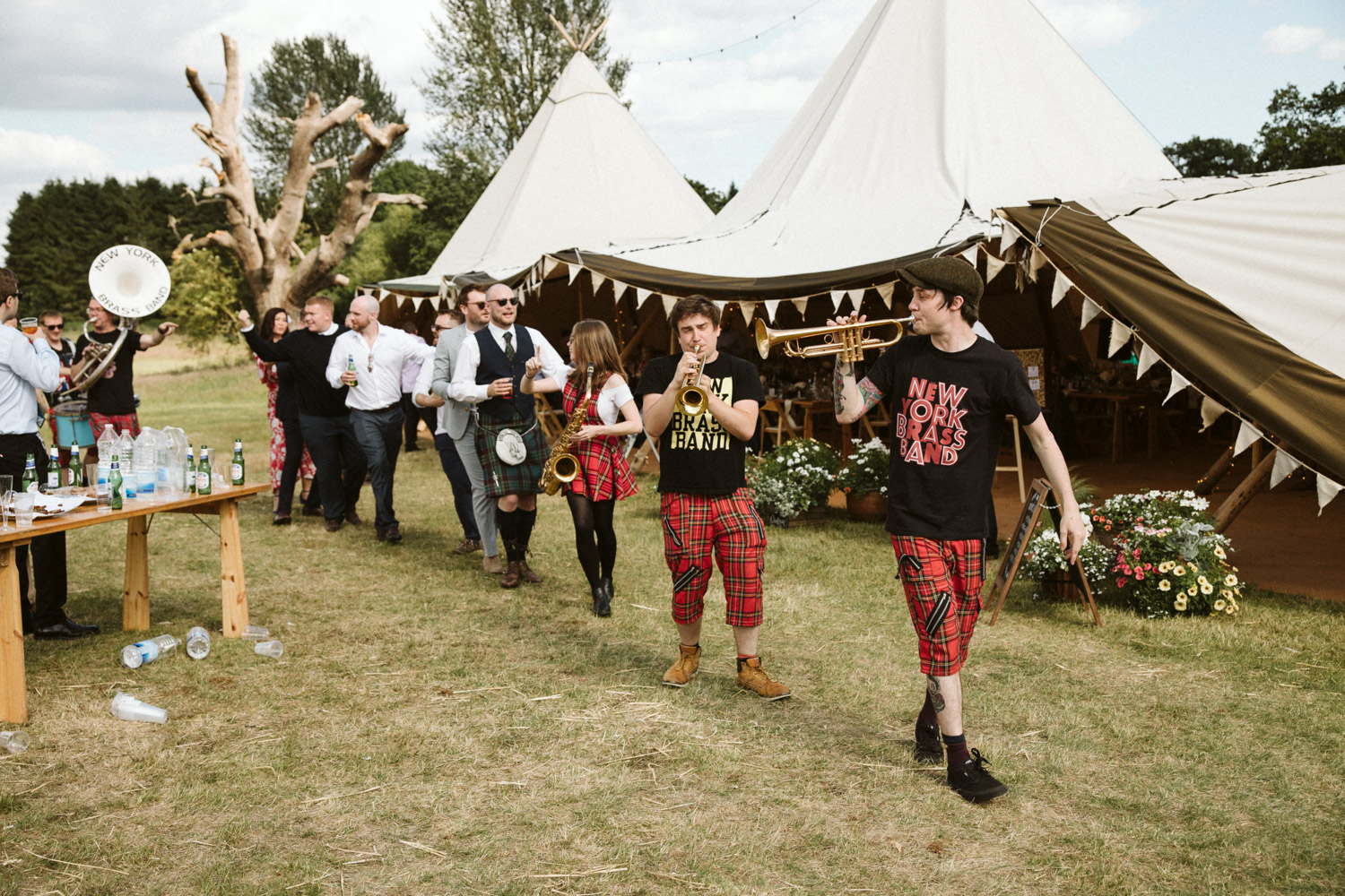 The New York brass band leading guests around the tipi